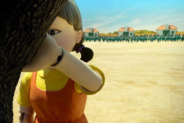 第1ゲーム「だるまさんが転んだ」で巨大な人形が振り向いた際に動いた者は、銃で撃たれ脱落となる